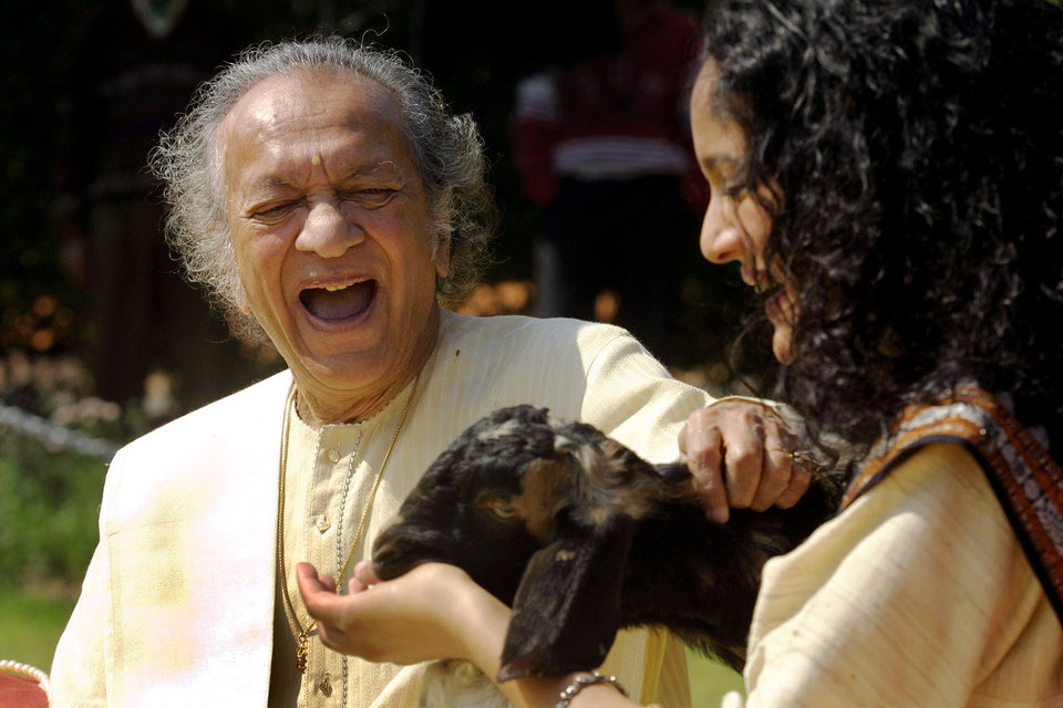 Photo - FILE - In this Feb. 25, 2002 file photo, Sitar maestro Pandit Ravi Shankar, left, and his daughter Anoushka Shankar laugh during the shooting of a film endorsing the strengthening of Indian laws against animal cruelty in New Delhi. Shankar, the sitar virtuoso who became a hippie musical icon of the 1960s after hobnobbing with the Beatles and who introduced traditional Indian ragas to Western audiences over an eight-decade career, died Tuesday, Dec. 11, 2012. He was 92. (AP photo/Gurinder Osan, File)