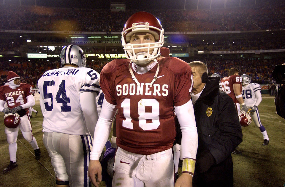 Kansas City , MU, Saturday December 6, 2003. COLLEGE FOOTBALL: The University of Oklahoma against Kansas State University during the BIG 12 Championship game at Arrowhead Stadium. Jason White walks off the field after OU\'s loss. Staff photo by Bryan Terry
