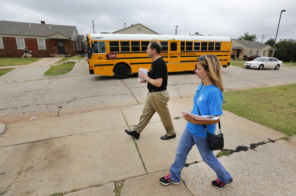 Christy Watson, communications director for the Foundation for Oklahoma City Public Schools, and schools Superintendent Karl Springer walk door to door, asking parents to enroll students in Thelma R. Parks Elementary School. PHOTO BY STEVE GOOCH, THE OKLAHOMAN <strong>Steve Gooch</strong>