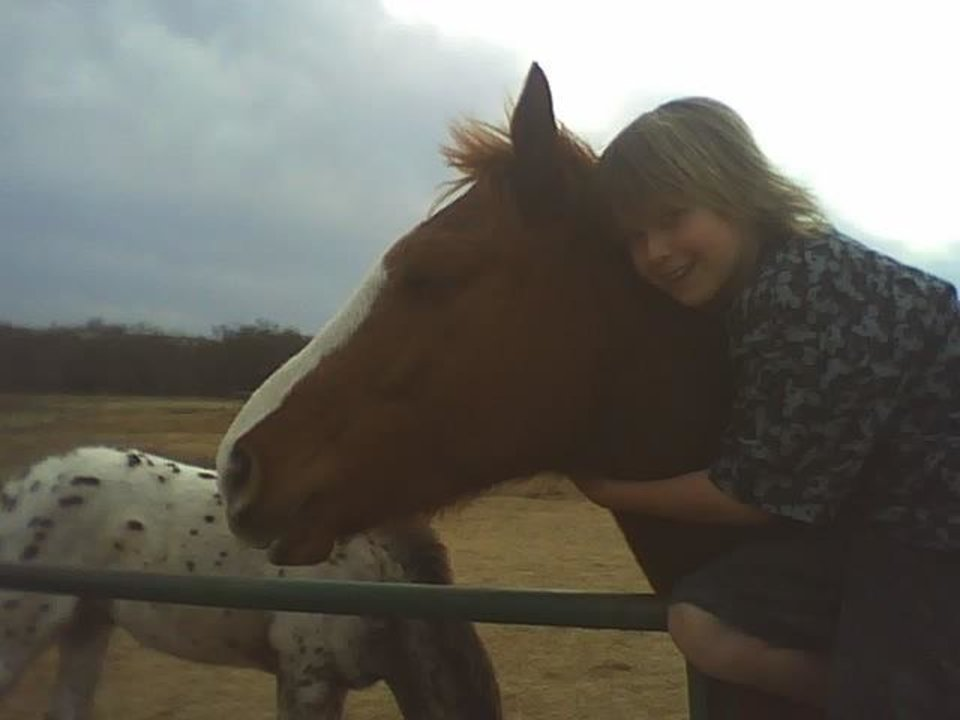 giving a horse a hug.. Kash 10 years old...<br/><b>Community Photo By:</b> Tama<br/><b>Submitted By:</b> Tama, Midwest