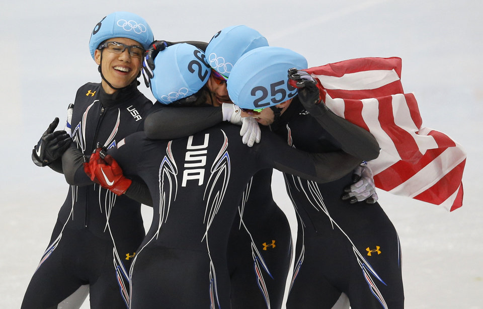 Photo - From left, J.R. Celski of the United States, Jordan Malone of the United States, Eduardo Alvarez of the United States and Chris Creveling of the United States celebrate their second place finish in the men's 5000m short track speedskating relay final at the Iceberg Skating Palace during the 2014 Winter Olympics, Friday, Feb. 21, 2014, in Sochi, Russia. (AP Photo/Vadim Ghirda)