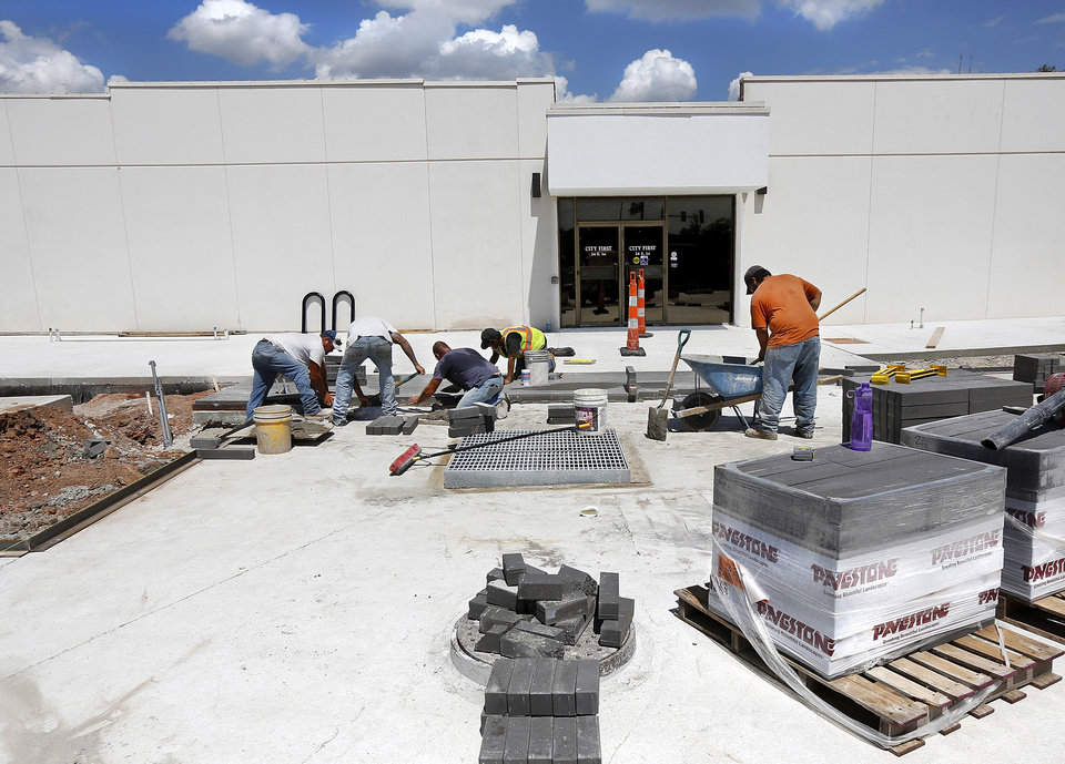 Photo -  A crew from Rudy Construction Co. works on the new 54-spot parking lot on the south side of Edmond's city hall at Second Street and Littler Avenue. [STAFF PHOTO BY JIM BECKEL, THE OKLAHOMAN]