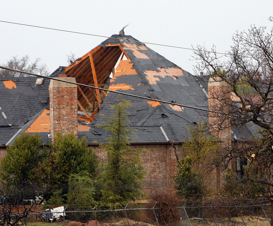 Photo - Home damaged by the tornado near Sorghum Mill and Kelly, Tuesday , February 10, 2009.  By David McDaniel, The Oklahoman. O