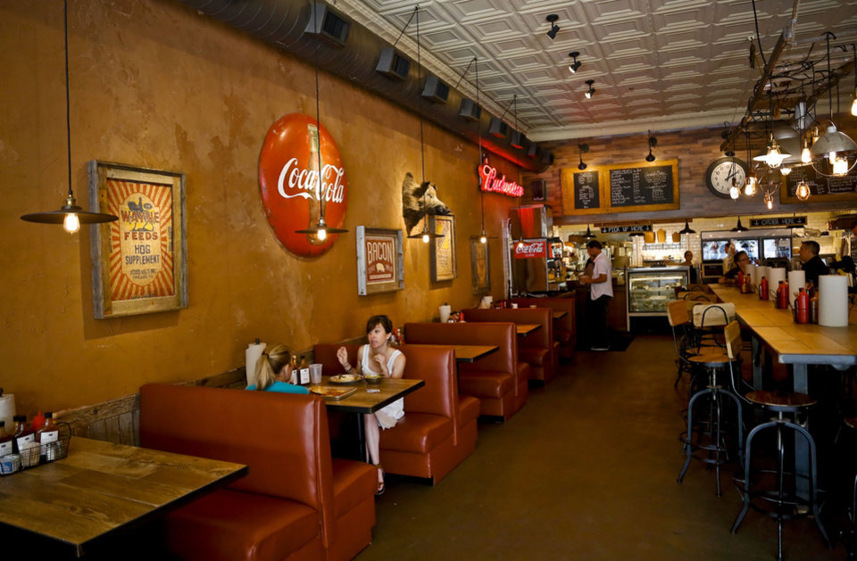 Photo - The dining area at the new Back Door Barbecue at 315 NW 23 in Oklahoma City. Photo by Chris Landsberger, The Oklahoman  CHRIS LANDSBERGER - CHRIS LANDSBERGER