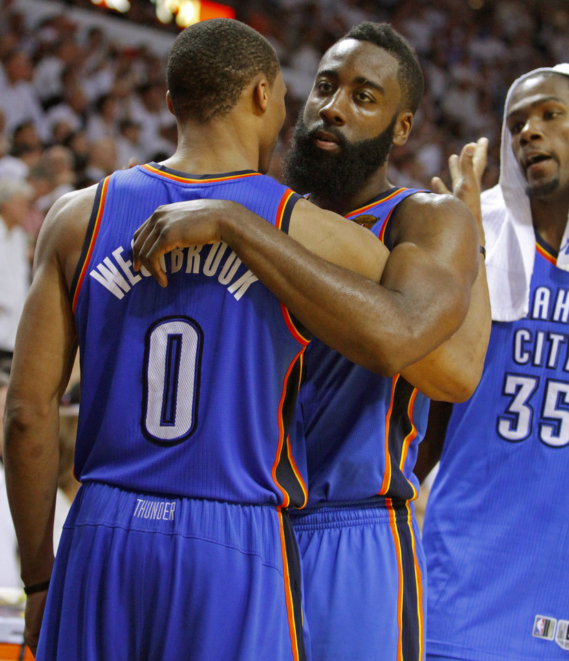 Photo - Oklahoma City's James Harden, center, hugs Russell Westbrook, as Kevin Durant watches during the final minutes of Game 5 of the NBA Finals between the Oklahoma City Thunder and the Miami Heat at American Airlines Arena, Thursday, June 21, 2012. Oklahoma City lost 121-106. Photo by Bryan Terry, The Oklahoman