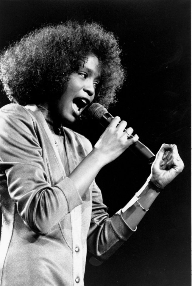 In this May 10, 1986, file photo, American singer Whitney Houston belts out a song during her segment of a benefit concert at Boston Garden. Houston died Saturday, Feb. 11, 2012, she was 48. (AP Photo/Elise Amendola) ORG XMIT: NY124