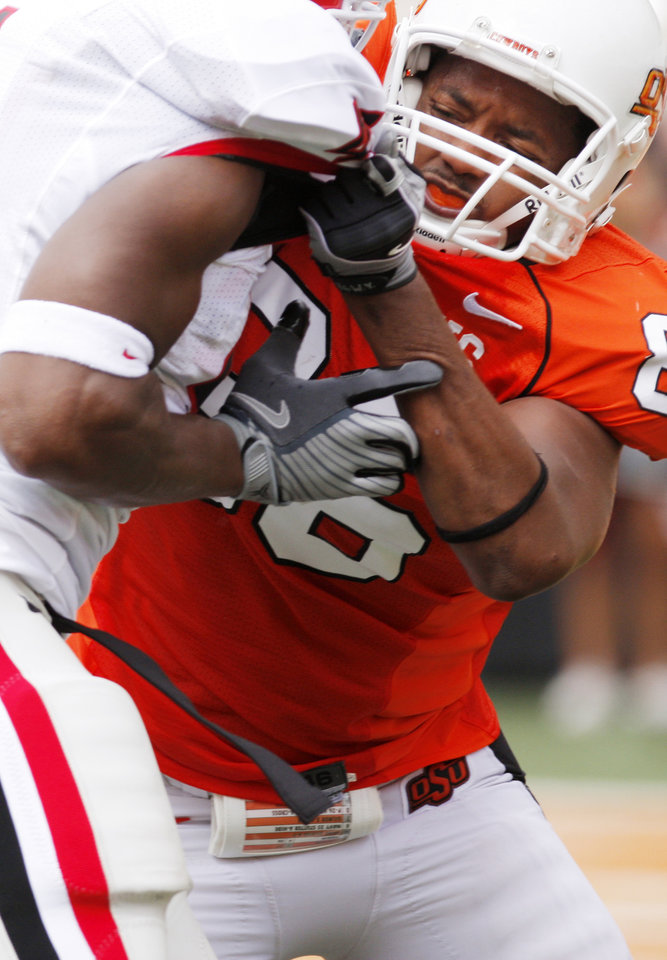 Photo - Wilson Youman (86) during the college football game between OSU and the University of Georgia at Boone Pickens Stadium on the campus of Oklahoma State University in Stillwater Saturday, Sept. 5, 2009. Photo by Doug Hoke, The Oklahoman. ORG XMIT: KOD