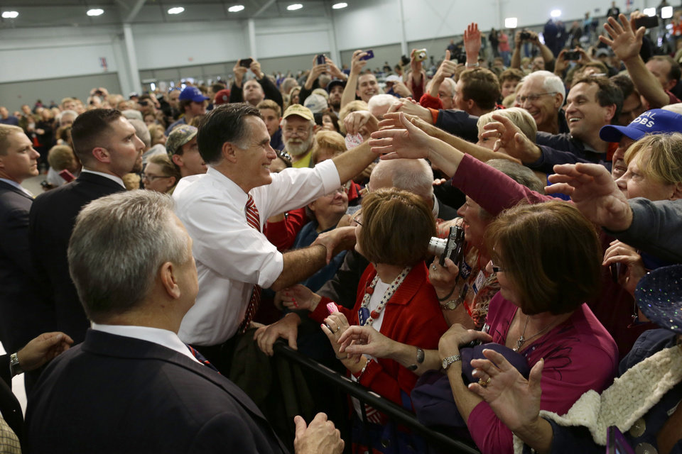 Photo -   FILE - This Nov. 1, 2012 file photo shows Republican presidential candidate, former Massachusetts Gov. Mitt Romney greeting supporters at a campaign stop at Meadow Event Park in Richmond, Va. Romney calls it the