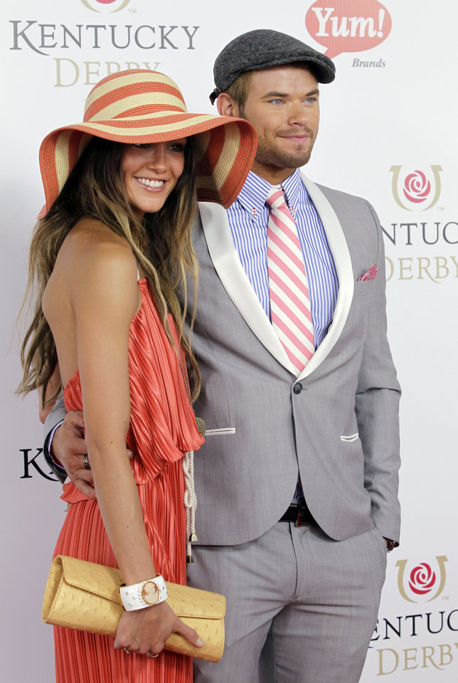Photo - Twilight series actor Kellan Lutz arrives with a guest for the 138th Kentucky Derby horse race at Churchill Downs Saturday, May 5, 2012, in Louisville, Ky. (AP Photo/Darron Cummings)  ORG XMIT: DBY140