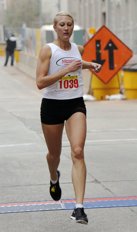 Dawn Nagazina is the first place female finisher in the SandRidge Santa Run in downtown Oklahoma City, OK, Saturday, December 8, 2012,  By Paul Hellstern, The Oklahoman