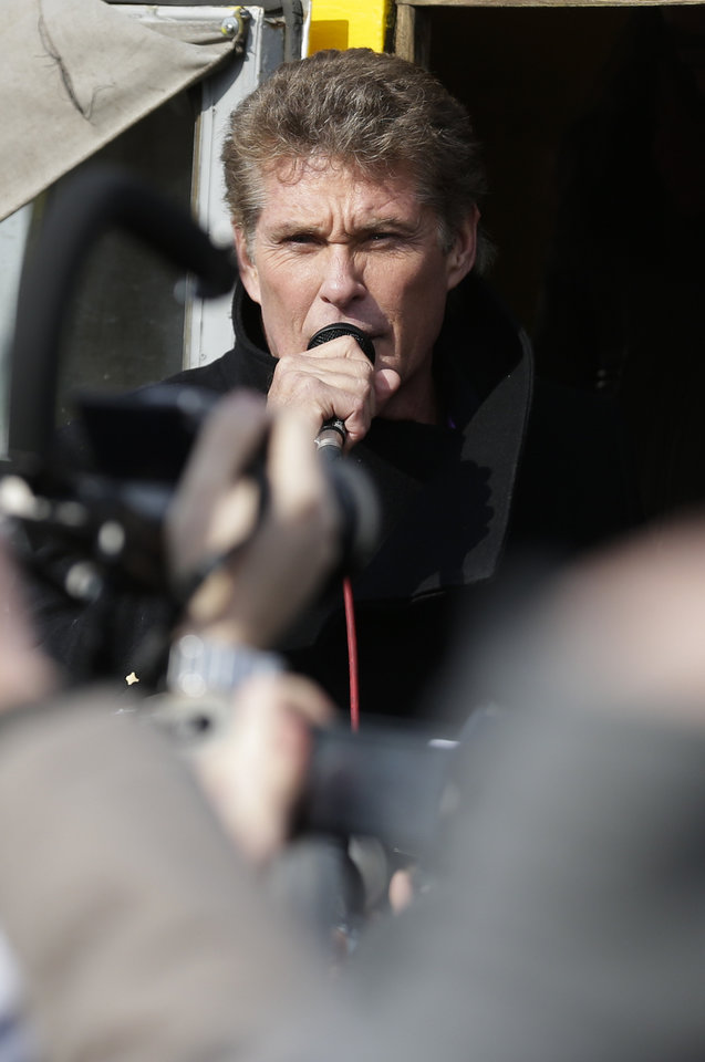 Photo - US actor David Hasselhoff speaks to the crowed from a truck as he attends a protest against the removal of a section of the East Side Gallery, a historic part of the former Berlin Wall, in Berlin, Sunday, March 17, 2013. Hasselhoff is fondly remembered by many Germans for releasing a song called