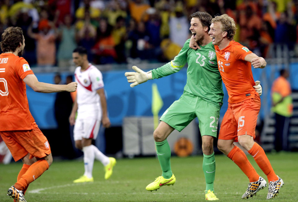 Photo - Netherlands' goalkeeper Tim Krul (23) celebrates with teammate Dirk Kuyt, right,  after saving his second penalty kick during the World Cup quarterfinal soccer match between the Netherlands and Costa Rica at the Arena Fonte Nova in Salvador, Brazil, Saturday, July 5, 2014. The Netherlands won 4-3 on penalty kicks. (AP Photo/Hassan Ammar)