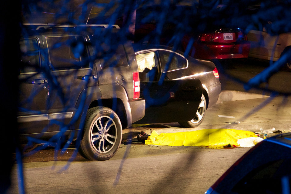 Photo - This photo shows the scene of a drive-by shooting that left seven people dead, including the attacker, and others wounded on Friday, May 23, 2014, in Isla Vista, Calif. Alan Shifman an attorney for Hollywood director Peter Rodger, who was an assistant director on The Hunger Games, said the family believes Rodger's son, Elliot Rodger, is responsible for the shooting rampage near the Santa Barbara, California, university campus. Authorities have not confirmed the identity of the shooter. (AP Photo/The News-Press, Peter Vandenbelt)
