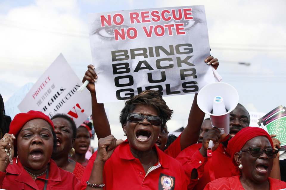 Photo - FILE- In this Monday, May 5, 2014 file photo, women attend a demonstration calling on the government to rescue kidnapped school girls of a government secondary school in Chibok, Nigeria, in Lagos. At least 11 parents of the more than 200 kidnapped Nigerian schoolgirls will never see their daughters again. Since the mass abduction of the schoolgirls by Islamic extremists three months ago, at least 11 of their parents have died and their hometown, Chibok, is under siege from the militants, residents report. Seven fathers of kidnapped girls were among 51 bodies brought to Chibok hospital after an attack on the nearby village of Kautakari this month, said a health worker who insisted on anonymity for fear of reprisals by the extremists.At least four more parents have died of heart failure, high blood pressure and other illnesses that the community blames on trauma due to the mass abduction 100 days ago, said community leader Pogu Bitrus, who provided their names. (AP Photo/ Sunday Alamba, File)