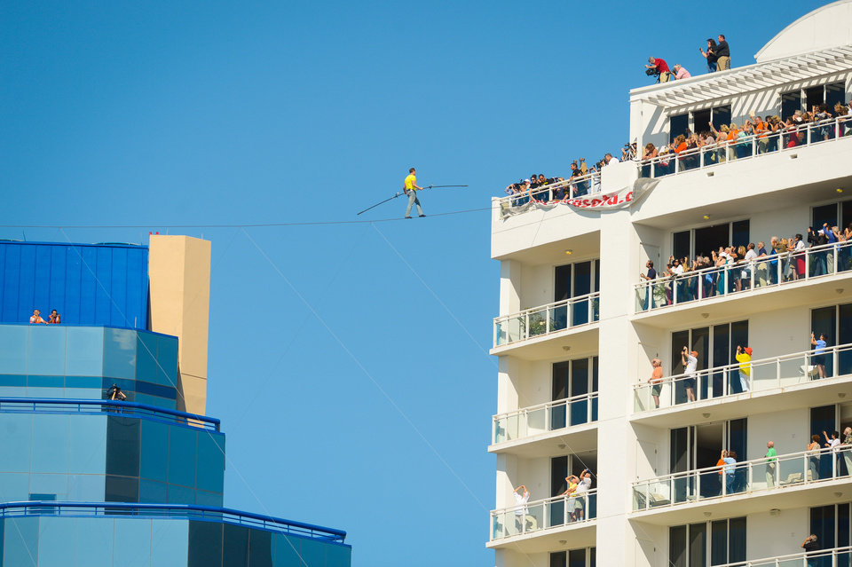 Aerialist Nick Wallenda walks the high wire 200 feet over U.S. 41 in Sarasota, Fla., without a safety harness on Tuesday, Jan. 29, 2013.  The Sarasota City Commission is allowing him to do the stunt without a tether. Wallenda wore a tether for the first time last summer when he walked across Niagara Falls because the television network that was paying for the performance insisted on it. (AP Photo/Sarasota Herald-Tribune, Mike Lang)  PORT CHARLOTTE OUT; BRADENTON HERALD OUT; TV OUT;  ONLINE OUT