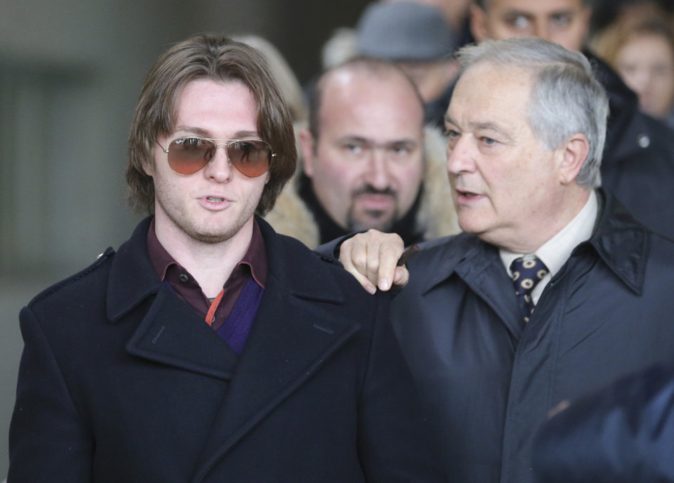 Photo - Raffaele Sollecito, left, and his father Francesco leave after attending the final hearing before the third court verdict for the murder of British student Meredith Kercher, in Florence, Italy, Thursday, Jan. 30, 2014. The first two trials produced flip-flop verdicts of guilty then innocent for Kercher former roommate, American student Amanda Knox, who is not attending the hearing,  and her former Italian boyfriend, Raffaele Sollecito, and the case has produced harshly clashing versions of events. A Florence appeals panel designated by Italy's supreme court to address issues it raised about the acquittal is set to deliberate Thursday, with a verdict expected later in the day. (AP Photo/Antonio Calanni)