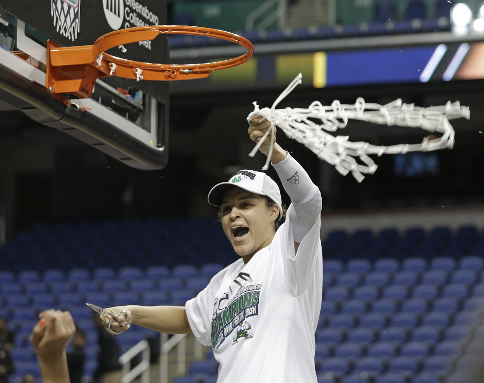 Photo - Notre Dame's Kayla McBride celebrates after defeating Duke in the NCAA college basketball championship game of the Atlantic Coast Conference tournament in Greensboro, N.C., Sunday, March 9, 2014. Notre Dame won 69-53. (AP Photo/Chuck Burton)