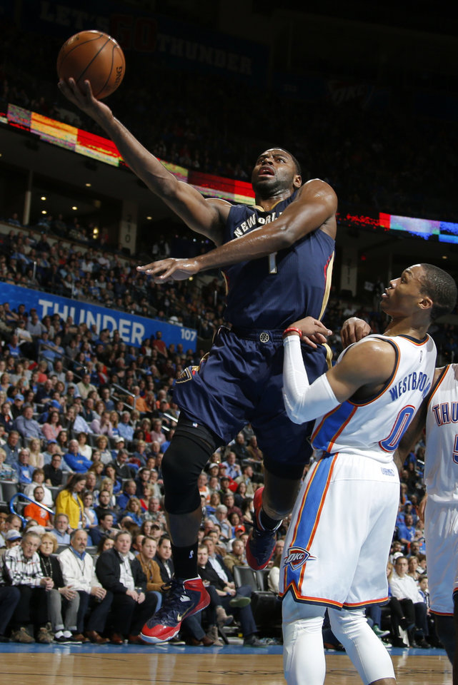 Photo - New Orleans' Tyreke Evans (1) goes to the basket past Oklahoma City's Russell Westbrook (0) during an NBA game between the Oklahoma City Thunder and the New Orleans Pelicans at Chesapeake Energy Arena on Friday, Feb. 6, 2015. Photo by Bryan Terry, The Oklahoman