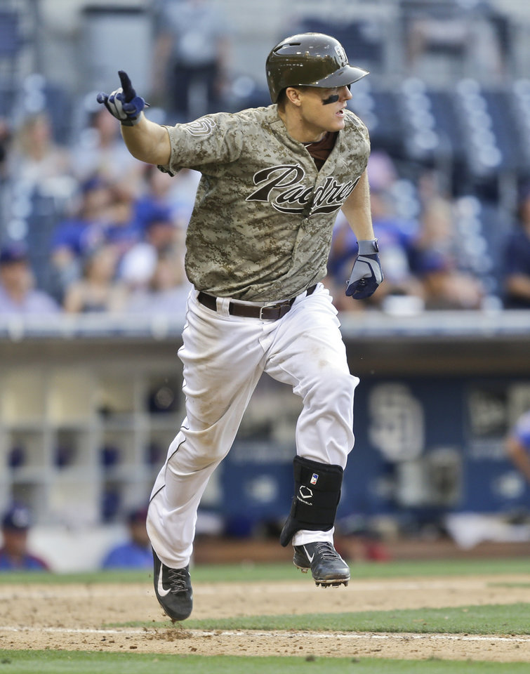 Photo - San Diego Padres' Nick Hundley raises a finger as he starts to celebrate his game wining hit that gave the Padres a 3-2 victory over the Chicago Cubs in the fifteenth inning of a baseball game Sunday, Aug. 25, 2013, in San Diego. (AP Photo/Lenny Ignelzi)