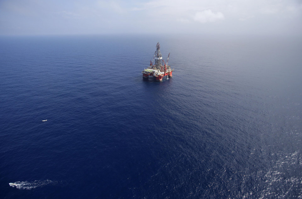 Photo - FILE - In this Nov. 22, 2013, file photo, the Centenario deep-water drilling platform stands off the coast of Veracruz, Mexico in the Gulf of Mexico. The administration of Mexico's President Enrique Pena has passed laws on Aug. 7, 2014, to open its oil, gas and electric industries to private and foreign investors after 76 years of state control. (AP Photo/Dario Lopez-Mills, File)