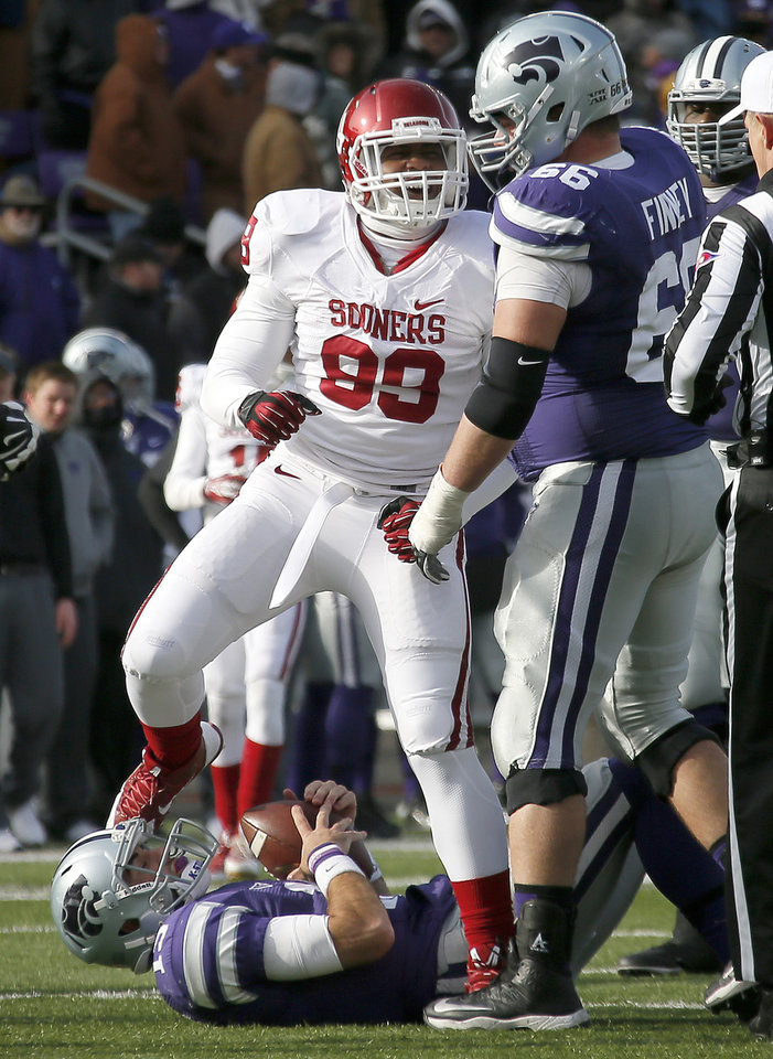 Oklahoma\'s Chaz Nelson (99) celebrates over Kansas State\'s Jake Waters (15) during an NCAA college football game between the Oklahoma Sooners and the Kansas State University Wildcats at Bill Snyder Family Stadium in Manhattan, Kan., Saturday, Nov. 23, 2013. Oklahoma won 41-31. Photo by Bryan Terry, The Oklahoman