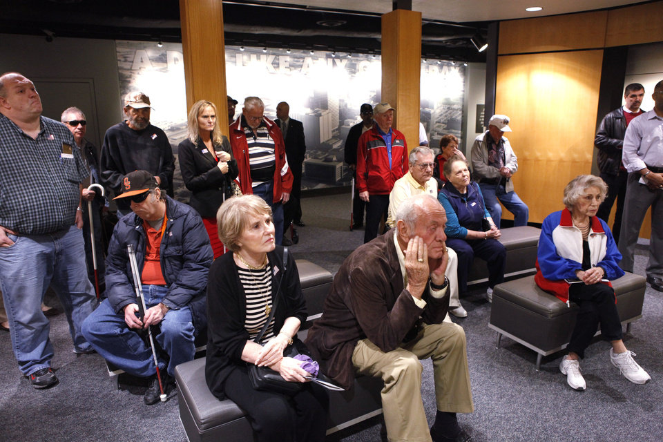 Volunteers and members of a support group for blind and visually impaired veterans tour the memorial museum Friday. Photos by David McDaniel, The Oklahoman