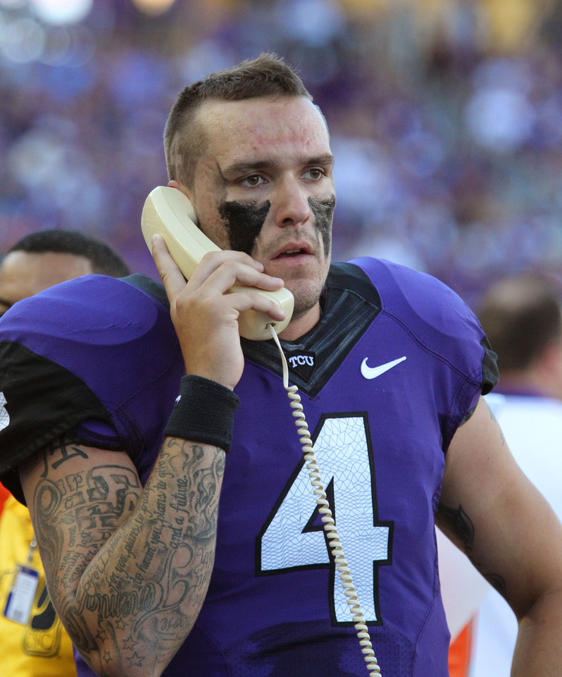 Photo -   This Sept. 8, 2012 file photo shows TCU quarterback Casey Pachall (4) on the field phone to the booth during a game against Grambling State, in Fort Worth, Texas. Pachall has been suspended indefinitely after he was arrested on suspicion of driving while intoxicated. Coach Gary Patterson announced the suspension Thursday morning, Oct. 4, 2012, hours after police say Pachall was pulled over for running a stop sign near TCU's Fort Worth campus. (AP Photo/Fort Worth Star-Telegram/Paul Moseley) MAGS OUT; (FORT WORTH WEEKLY, 360 WEST); INTERNET OUT