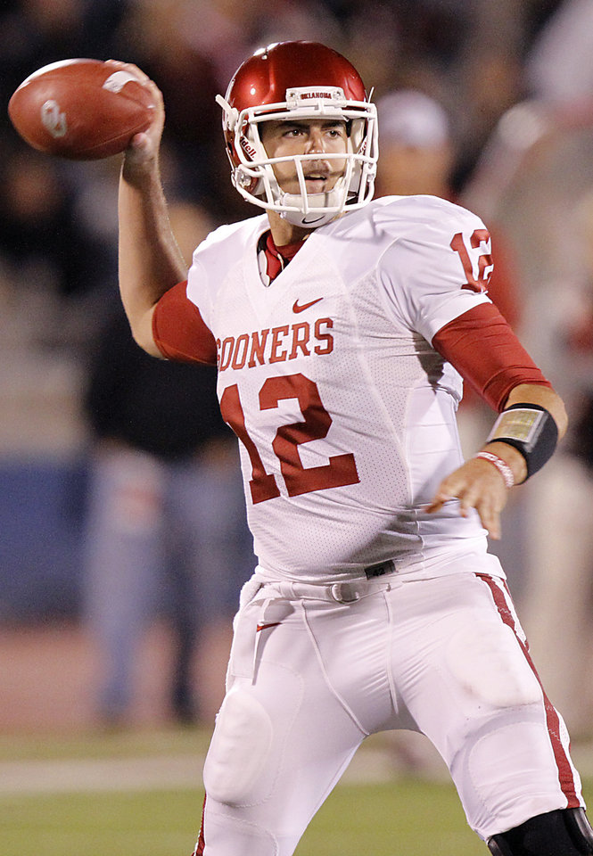 Photo - Oklahoma's Landry Jones (12) passes the ball during the college football game between the University of Oklahoma Sooners (OU) and the University of Kansas Jayhawks (KU) on Saturday, Oct. 15, 2011. in Lawrence, Kan. Photo by Chris Landsberger, The Oklahoman