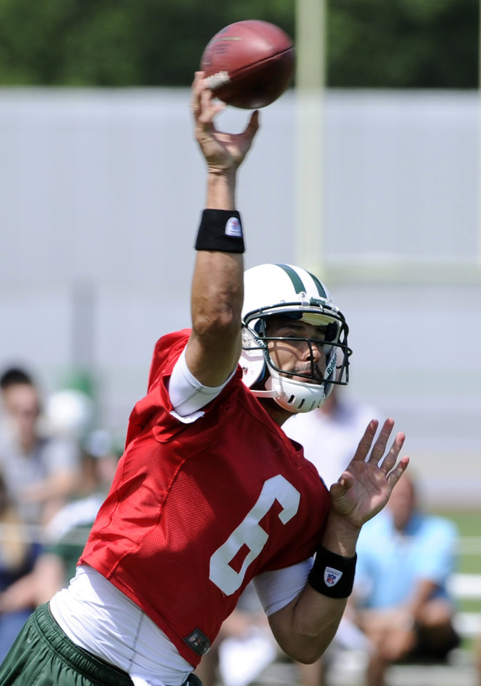 Photo - New York Jets quarterback Mark Sanchez throws a pass during NFL football practice Wednesday, June 5, 2013, in Florham Park, N.J. (AP Photo/Bill Kostroun)