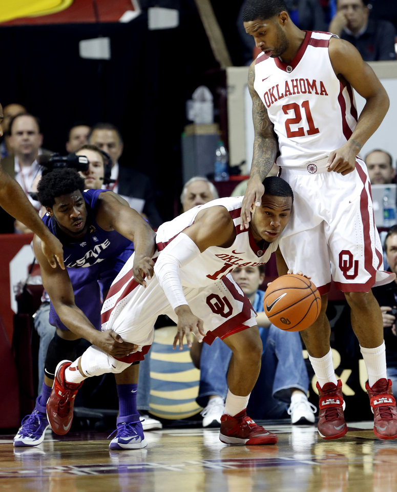 Photo - Oklahoma's Jordan Woodard (10) steals the ball from Nino Williams (11) as Cameron Clark (21) watches during the first half against Kansas State in an NCAA college basketball game Saturday, Feb. 22, 2014 in Norman, Okla. (AP Photo//The Oklahoman, Steve Sisney)