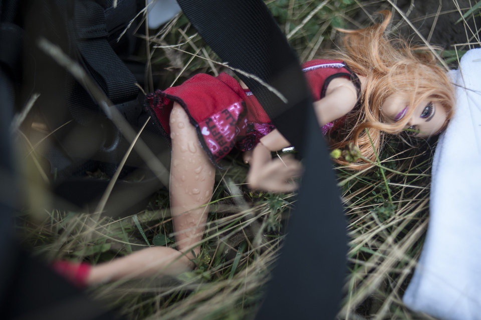 Photo - A doll lies at the crash site of a Malaysia Airlines jet near the village of Hrabove, eastern Ukraine, Saturday, July 19, 2014. World leaders demanded Friday that pro-Russia rebels who control the eastern Ukraine crash site of Malaysia Airlines Flight 17 give immediate, unfettered access to independent investigators to determine who shot down the plane. (AP Photo/Evgeniy Maloletka)