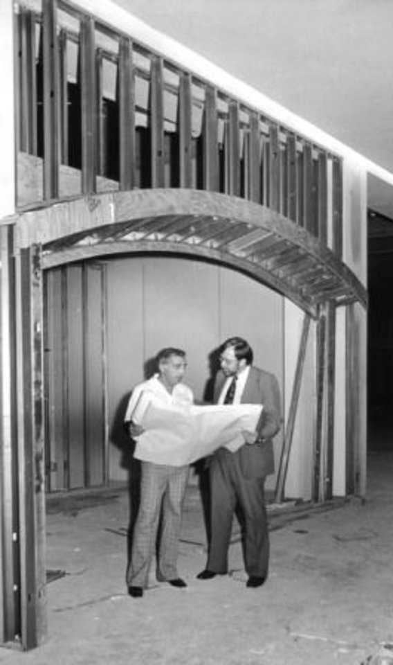 Robert Lackmeyer, right, overlooks plans for Century Center Mall with Mario Posillico inside an unfinished storefront in the mall.