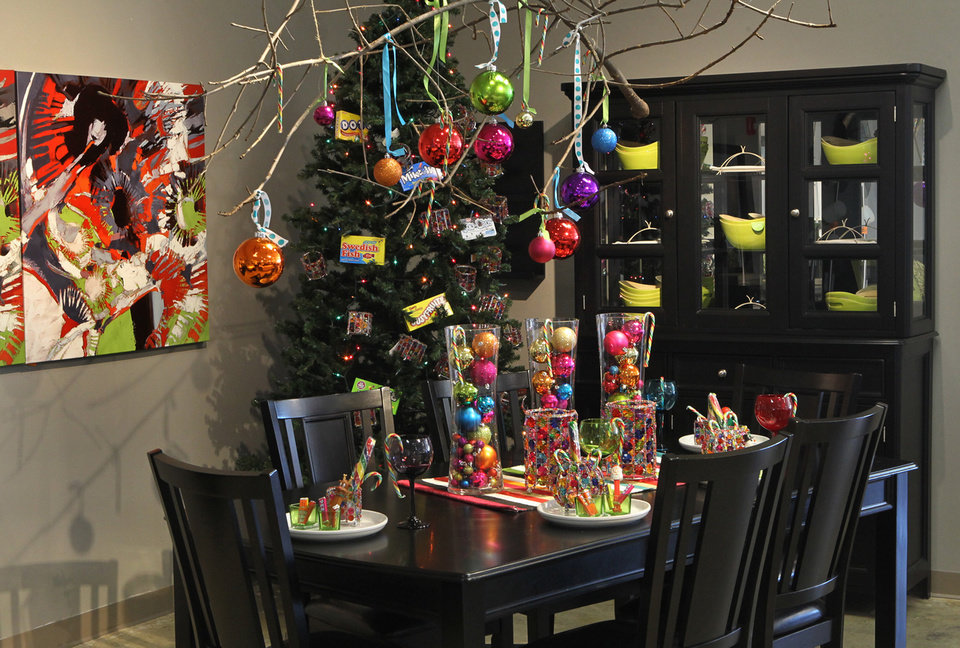 The designers at Ashley Furniture in Ballwin, Missouri set up several holiday decor scenes in their showroom on Manchester Road, November 13, 2012. A second colorful dining room display utilizes holiday ornaments for a hanging display and a table centerpiece. (J.B. Forbes/St. Louis Post-Dispatch/MCT)