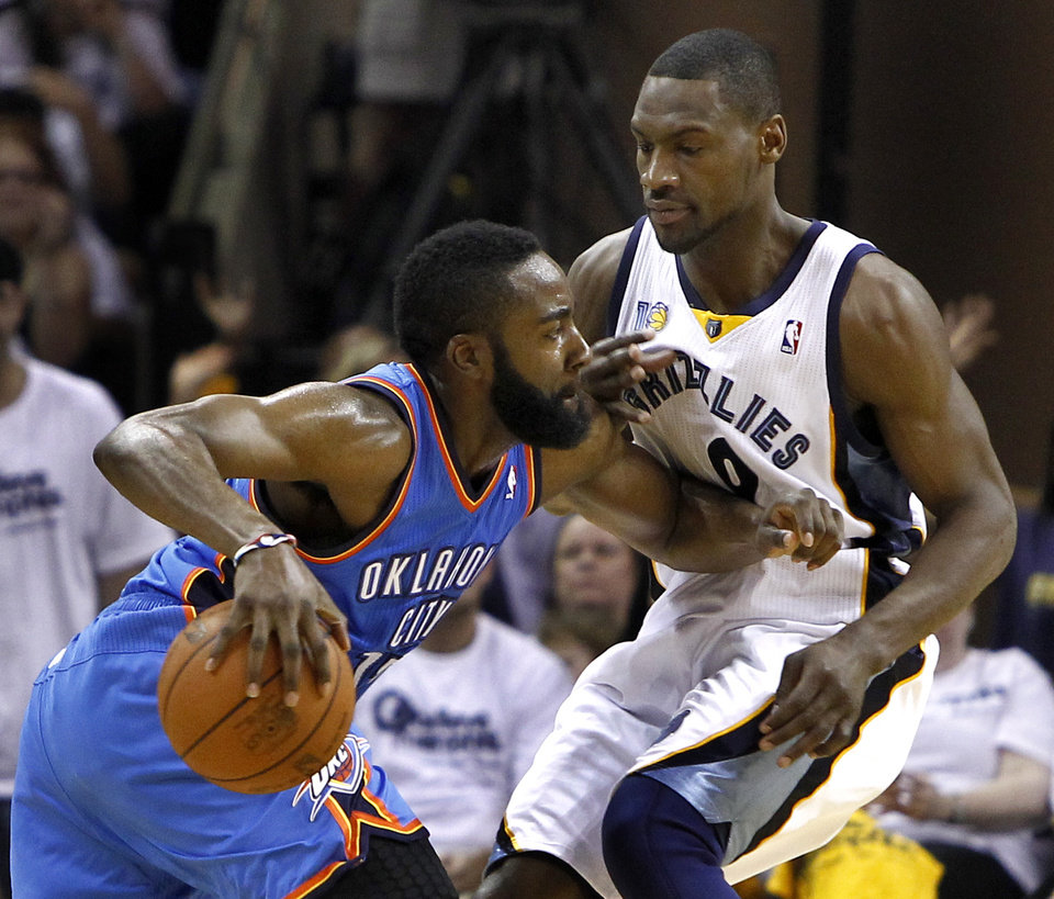 Photo - Oklahoma City Thunder guard James Harden, left, drives against Memphis Grizzlies guard Tony Allen during the first half of Game 4 of a second-round NBA basketball playoff series on Monday, May 9, 2011, in Memphis, Tenn. (AP Photo/Wade Payne)