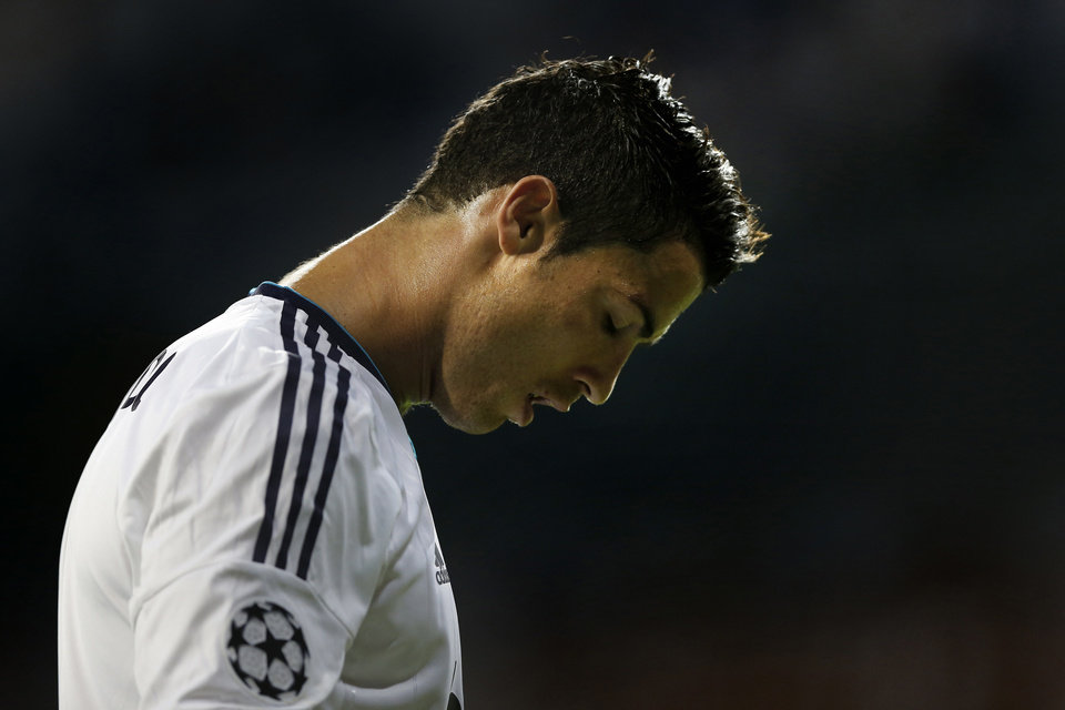 Photo -   Real Madrid's Cristiano Ronaldo from Portugal reacts during a Champions League Group D soccer match against Manchester City at the Santiago Bernabeu Stadium, in Madrid, Tuesday, Sept. 18, 2012. (AP Photo/Daniel Ochoa De Olza)