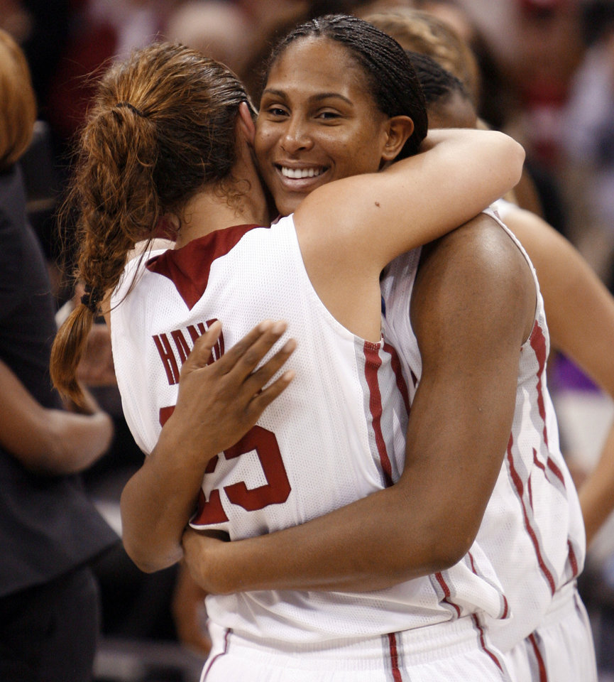Photo - Ashley Paris hugs Whitney Hand after their team's 74-68 win as the University of Oklahoma (OU) defeats Purdue in the NCAA women's basketball regional tournament finals at the Ford Center in Oklahoma City, Okla., on Tuesday, March 31, 2009.  Photo by Steve Sisney, The Oklahoman