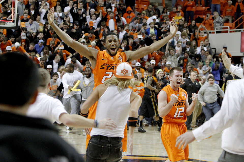 Oklahoma State's Michael Cobbins (20) and Keiton Page (12) celerbate as fans rush the court following an NCAA college basketball game between the Oklahoma State University Cowboys (OSU) and the Missouri Tigers (MU) at Gallagher-Iba Arena in Stillwater, Okla., Wednesday, Jan. 25, 2012. Oklahoma State won 79-72. Photo by Bryan Terry, The Oklahoman