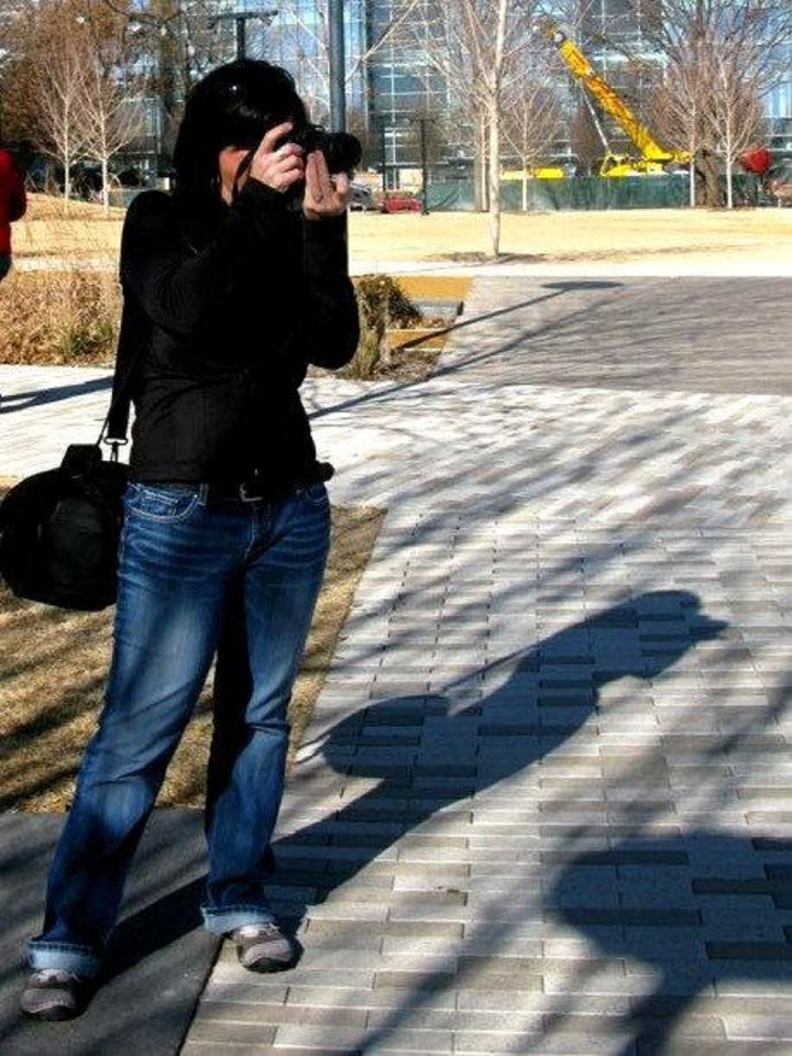 Photo - Leanna Keathley takes a photo during a recent meetup of users of the popular photography sharing site Instagram. Find her photos and others from the meetup by searching by the keyword