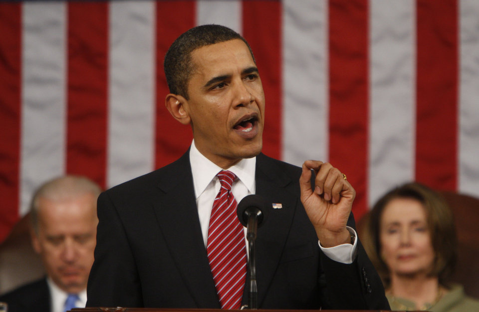 Photo - President Barack Obama addresses a joint session of Congress in the House Chamber of the Capitol in Washington, Tuesday, Feb. 24, 2009. (AP Photo/Pablo Martinez Monsivais, Pool) ORG XMIT: DCRL205