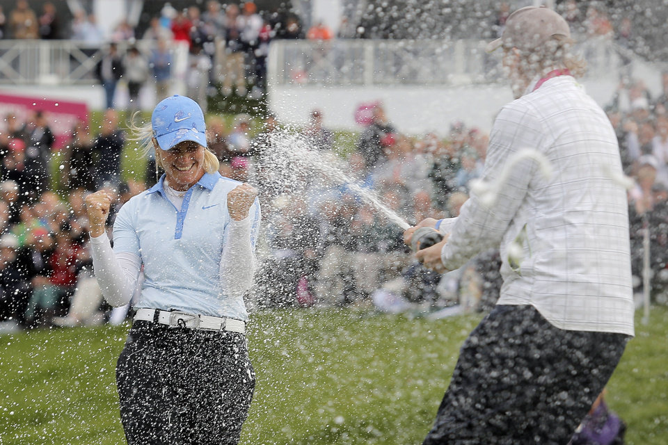 Photo - Suzann Pettersen of Norway is sprayed with champagne by a friend after winning the Evian Championship women's golf tournament in Evian, eastern France, Sunday, Sept. 15, 2013. (AP Photo/Laurent Cipriani)