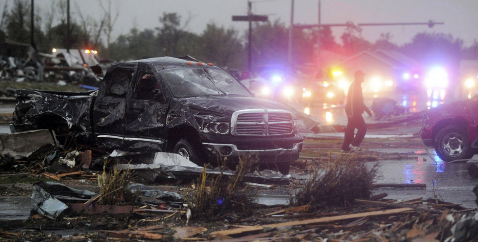 Photo - Emergency vehicles line up along northbound Rangeline Road  in Joplin, Mo. after a tornado swept through the city in Joplin, Mo. on Sunday evening, May 22, 2011. (AP Photo/The Joplin Globe, Roger Nomer) ORG XMIT: MOJOP106