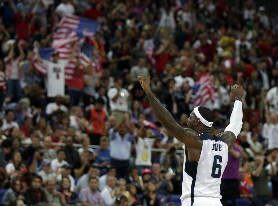 Photo - United States' LeBron James reacts during the men's gold medal basketball game against Spain at the 2012 Summer Olympics, Sunday, Aug. 12, 2012, in London. USA won 107-100. (AP Photo/Charles Krupa)