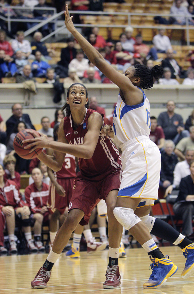 Oklahoma's Nicole Griffin, left, prepares to shoot over UCLA's Atonye Nyingifa during the second half of a second-round game in the women's NCAA college basketball tournament Monday, March 25, 2013, in Columbus, Ohio. Oklahoma beat UCLA 85-72. (AP Photo/Jay LaPrete) ORG XMIT: OHJL111