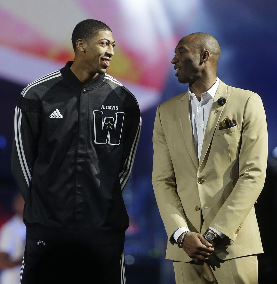 Photo - West Team's Anthony Davis, of the New Orleans Pelicans , left, speaks with Los Angeles Lakers Kobe Bryant during the NBA All Star basketball game, Sunday, Feb. 16, 2014, in New Orleans. (AP Photo/Gerald Herbert)