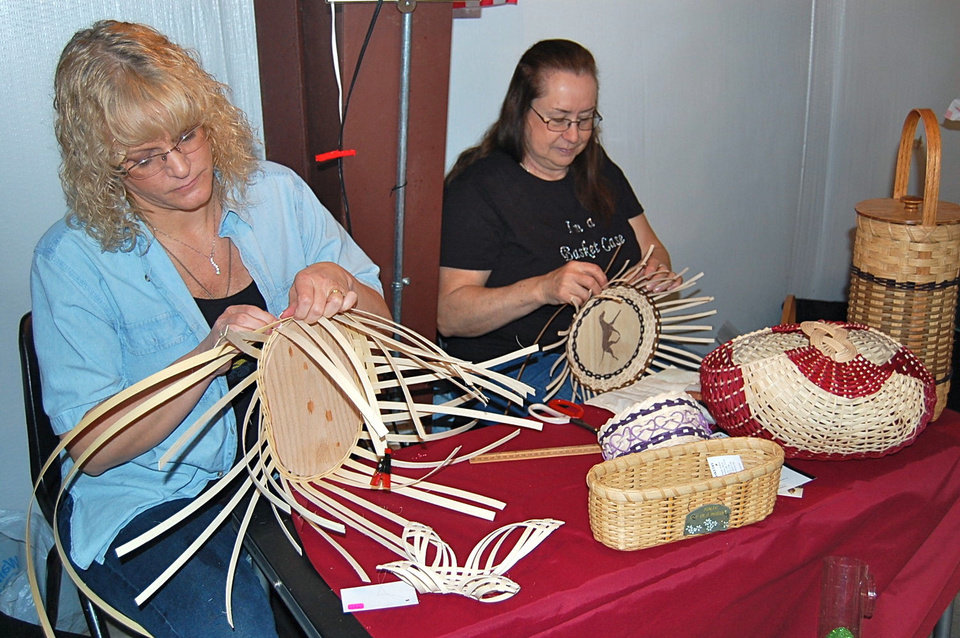Photo - Pauline Asbury, right, and her apprentice, Linda Reynolds, weave baskets at the Habasketry booth at the OSU-OKC Farmers Market in Oklahoma City.  Photos by Annette Price, for The Oklahoman