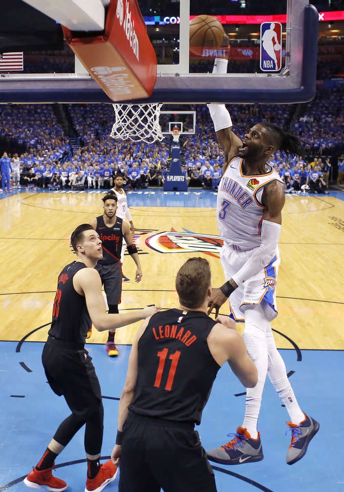 Photo - Oklahoma City's Nerlens Noel (3) dunks during Game 4 in the first round of the NBA playoffs between the Portland Trail Blazers and the Oklahoma City Thunder at Chesapeake Energy Arena in Oklahoma City, Sunday, April 21, 2019. Photo by Bryan Terry, The Oklahoman