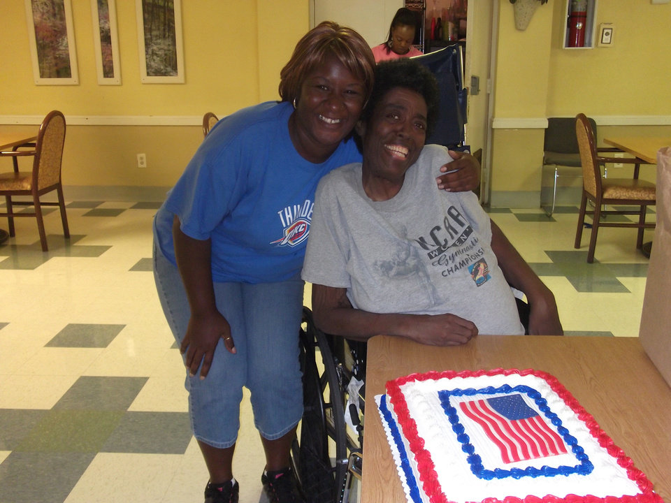 Grace Living Center NW 10 celebrated Flag Day on Thursday. Shown are employee Konnie Hester and resident Beverly Woody.
