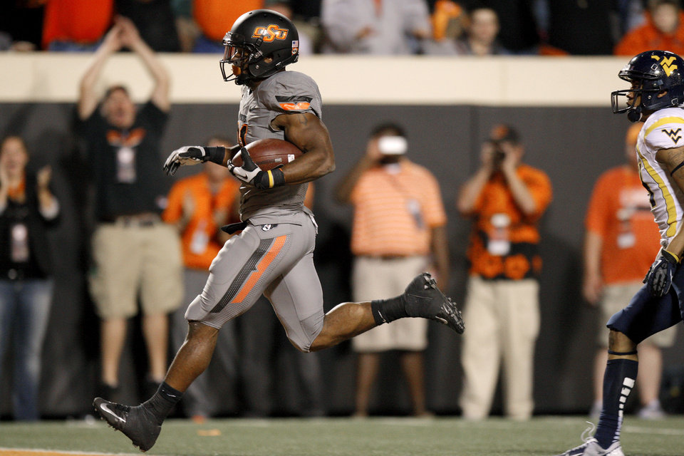 Photo - Oklahoma State's Jeremy Smith (31) runs for a touchdown during a college football game between Oklahoma State University (OSU) and West Virginia University at Boone Pickens Stadium in Stillwater, Okla., Saturday, Nov. 10, 2012. Oklahoma State won 55-34. Photo by Bryan Terry, The Oklahoman