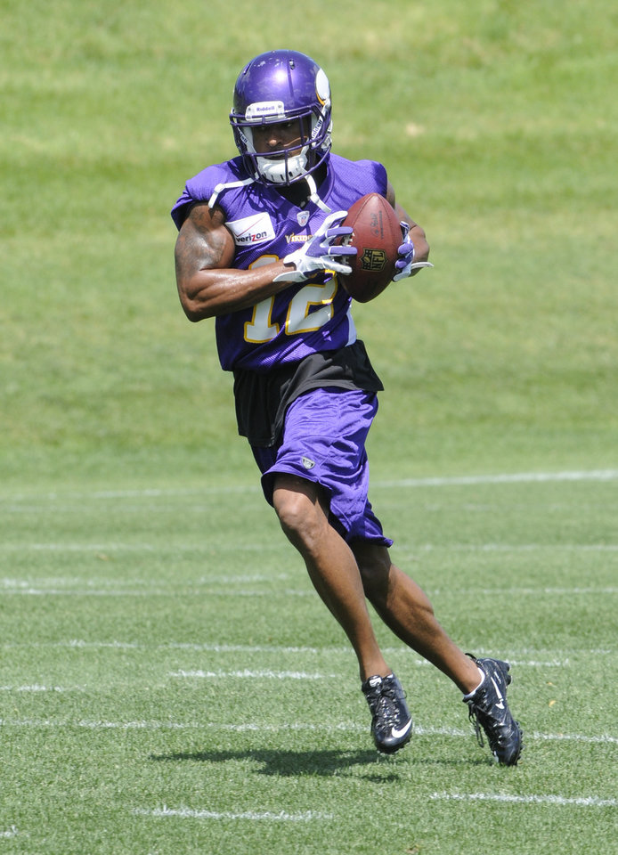 Photo -   Minnesota Vikings wide receiver Percy Harvin carries the ball during NFL football practice, Thursday, June 21, 2012, in Eden Prairie, Minn. Harvin has asked to be traded, saying earlier in the week he was upset with the team but not elaborating. (AP Photo/Jim Mone)