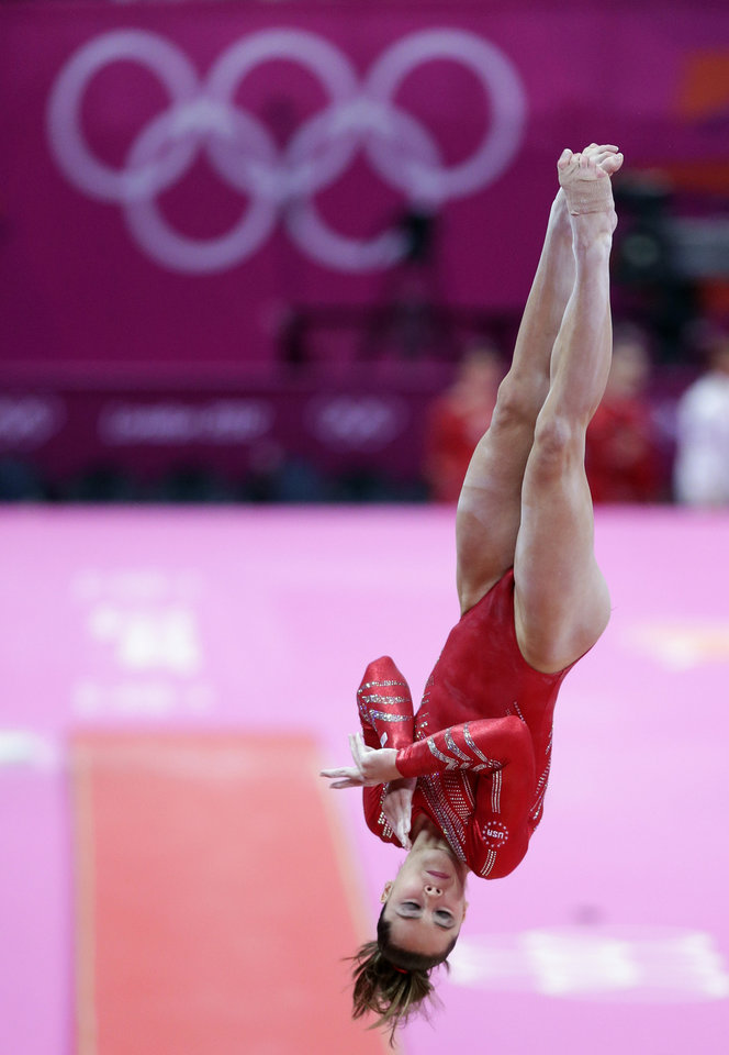 Photo -   U.S. gymnast McKayla Maroney performs on the vault during the Artistic Gymnastic women's team final at the 2012 Summer Olympics, Tuesday, July 31, 2012, in London. (AP Photo/Gregory Bull)